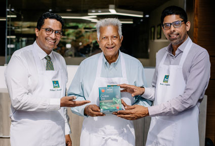 Dilmah Founder Merrill J Fernando with his sons Dilhan C Fernando and Ma...